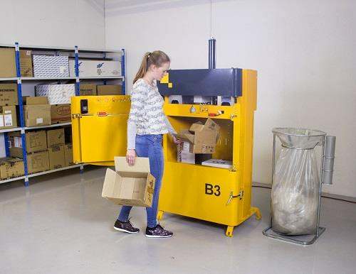 Baler B3 - loading the baler with waste, such as cardboard, plastic